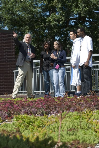"Dean Hunt and students on ""green"" roof"