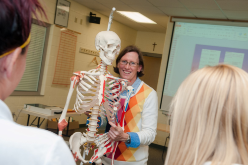 faculty member teaching with skeleton