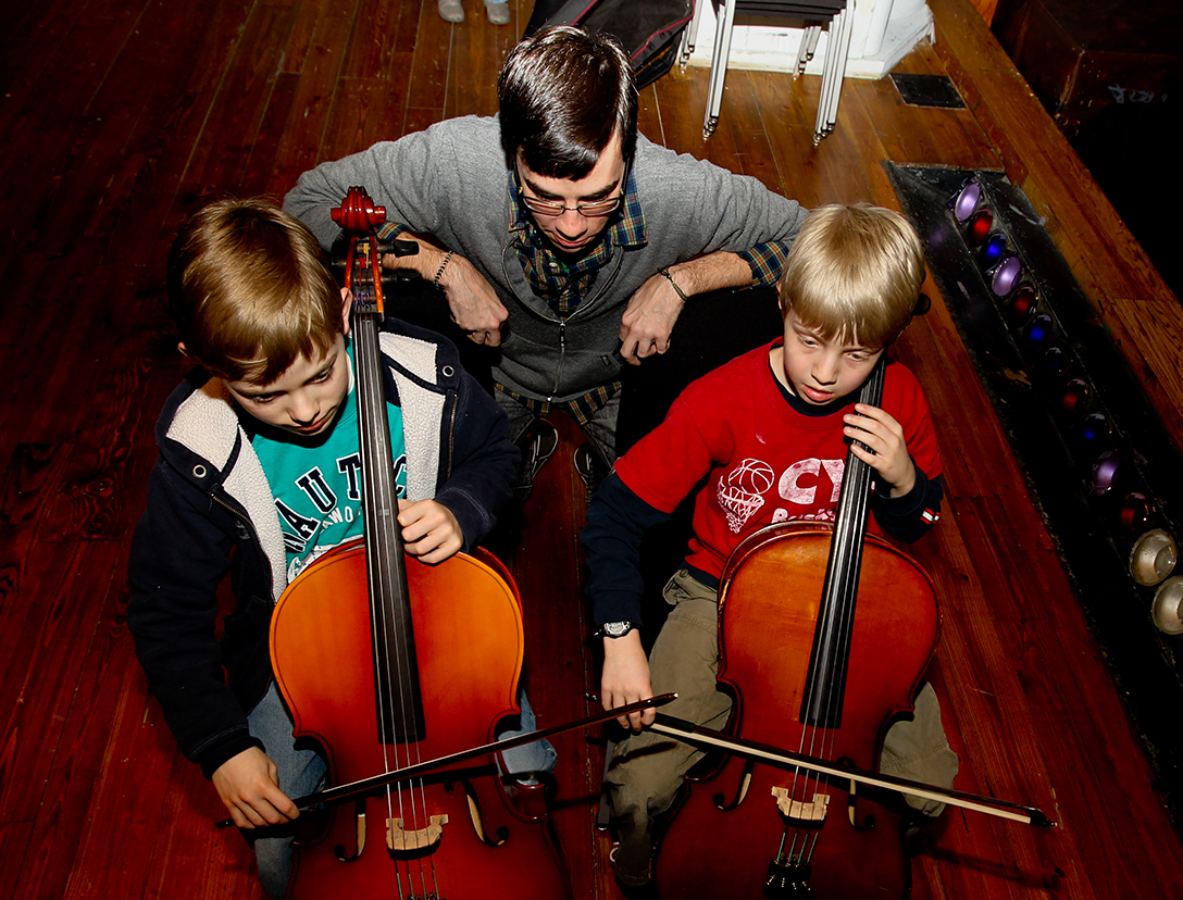 teacher with students cello