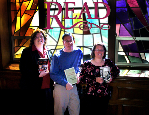 read faculty holding books