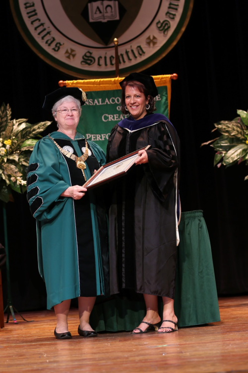 Photo of Dr Costanzi receiving the award
