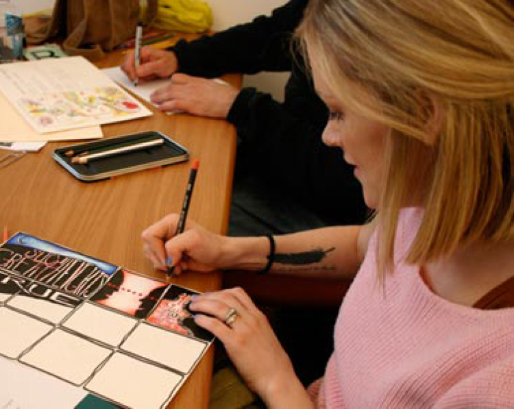 students illustrate at desk
