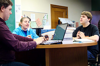 students at a table in the tutoring center